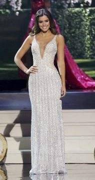 Miss Universe 2014 Paulina Vega Dieppa of Colombia wore this ivory sequined column gown from Colombian designer Alfredo Barraza.