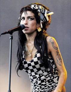 1983-2011 -- Amy Winehouse, the British pop singer whose hard-partying ways often overshadowed her soulful sound, died at just 27 years old on July 23. Winehouse struggled with drug addiction throughout her career, which began when she skyrocketed to fame with her hit 'Rehab'. The sultry singer's career was marred by her constant battle with drugs and family's public pleas for her to get help. She was found dead in her London flat.