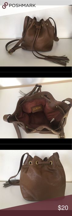 J. Crew Cognac mini bucket purse Great little bucket purse from J. Crew. Has some scratches from being used but is still in great condition. J. Crew Bags Mini Bags
