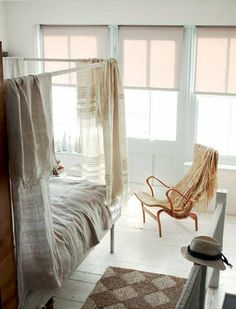 bedroom -- maybe get some linen/woven cloth like that, paint really bright flowers on it and hang above bed.
