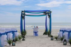 Beautiful blue beach wedding decoration. For the best officiant for your Outer Banks ceremony, or anywhere in NC, contact Rev. Dawn Marsh Gallogly, officiant4you.com/