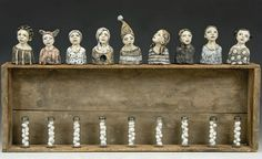 Elissa Farrow-Savos continues to create poignant narrative sculpture using polymer clay and found objects.