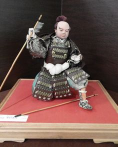 """Gofun Doll from the Meiji Period. Samurai is Carved Wood Covered with Gofun Paste. Handmade Garments. Base Measures 15.5"""" x 12.5"""" Height is 11"""""""