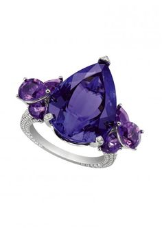 Chopard Temptations Collection. The luscious pear-shaped tanzanite with amethyst clusters shoulders to the delicate pavé-set diamond band.