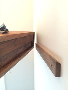 Our Floating Entryway Shelf is handmade from a single hardwood plank, highlighting a continuous wrap-around grain. Available in 4 lengths, this floating shelf mounts quickly and easily with an integrated french-cleat. We embed 3 rare-earth magnets on the underside for keys. The shelf depth is perfect for sunglasses, wallets, phones and your mail. Your choice of Black Walnut (shown), White Oak or Maple See this piece in White Oak here…