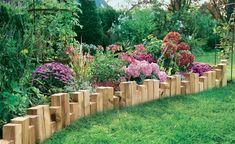 Kreativ-Idee für eine Beeteinfassung aus Holz