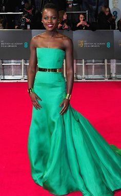 Razzle Dazzle from Lupita Nyong'o's Best Looks  At the 2014 BAFTAs the 12 Years A Slave star continued to wow us in yet another bold hue. This time she donned a emerald Dior gown.