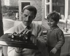 The iconic race pilot Graham Hill with his son, Damon Hill. A couple decades later, the son would also become a World F1 champion like his dad.