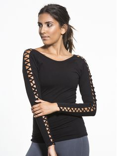 The perfect layer has arrived. This long sleeve fitted top has Picot Performance strappy detailing on each sleeve for a sexy look that's not over the top, while the cotton-blend fabric is soft enough that you'll want to wear it over and over again.