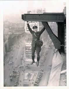 A 50's police officer hanging from a steel beam above Times Square. - Imgur