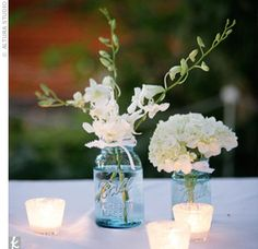 Love the blue mason jars. Looks beautiful with white flowers.