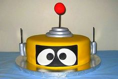 Robot cake-maybe use with the robot cupcake stand (cupcakes for kids) to slice for adults?