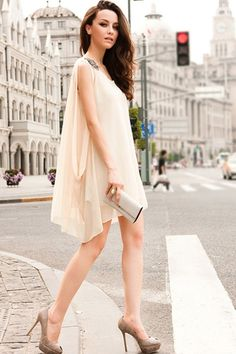 Cream dress and a white clutch paired with neutral heels for a simple yet classic chic evening look. Very appropriate for spring and summer!