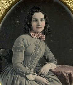 It is a nice, subtle tinting, and that dress is gorgeous. I like this girl. I believe it is a later daguerreotype than it is dated, ca. 1860.