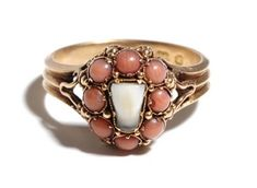 Ring with a real baby tooth. Gold and coral. Mid 19th century, Great Britain