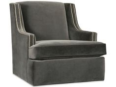 Two swivel rocker chairs in the family room facing the sofa with ...