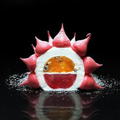 AntiPavlova cake. | mascarpone whipped cream, mango-passion fruit coulis, strawberry jelly, meringue.
