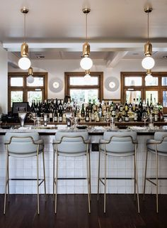 i like the bar top, white, and brass accents