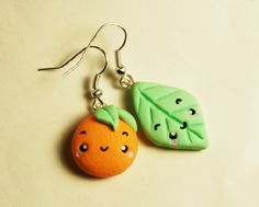 orange and leaf mismatch polymer clay earrings