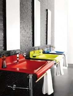 Primary colors | The bathroom is an interior space that shows primary colors because the sinks are red, yellow, and blue.