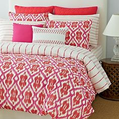 Tommy Hilfiger comforter set. A gorgeous pink and orange Ikat turns to pink stripes on the reverse in this stunning comforter set.