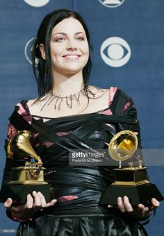 Singer Amy Lee of Evanescence poses with her two Grammys backstage in the…