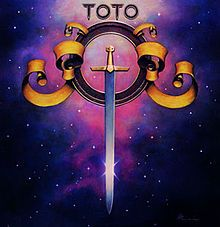 "Toto; self titled debut album with ""Rosanna"". Toto were formed in LA in the late 70s by a group of friends who were all much in demand session musicians. They went on to epitomise the classic American pop/rock sound of the 80s with hit albums and singles including multi-Grammy winning worldwide hit ""Rosanna"". This song won the Record of the Year Grammy Award in the 1983 and peaked at no.2 on the Billboard Hot 100"