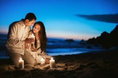 Light candles on the beach after sundown to add even more romance to your photos.
