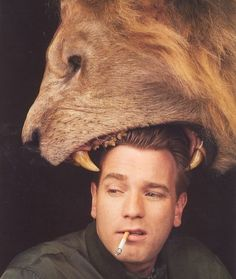 Ewan McGregor looking cool while a lion bites his head off