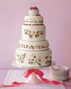 A charming cake embellished with tiny sugar flowers and topped with a basket of berries