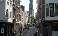 A street in the Jordaan with the Westertower on the background. Amsterdam