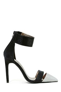 Amazing glittery pumps featuring a pointed toe with ankle strap and silver snakeskin toe detailing.