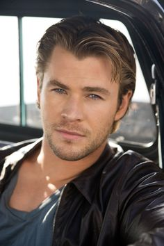 Chris Hemsworth  I don't usually go for blondes, but this man is gorgeous! Love his blue eyes! Oh, and the muscles! :-)