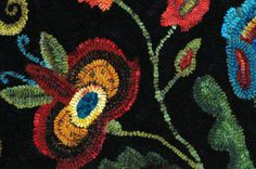 """What is it about jewel tone colors that makes a piece like this dance?  One piece is the complement pairs, even small areas of them--e.g., the red/green pairs and a bit of blue/orange.  Black gives it some depth, as do the shade variations in the wools themselves.  I've studied some about color, but feel like the more one learns, the less one really knows.  In the end, it's enough sometimes just to recognize that this is the nature color--marvelous and mysterious and primal and necessary."""""""
