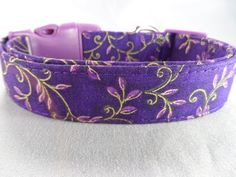 This is a beautiful and unique dog collar. It features elegant leaves outlined in gold foil, on a royal purple background. This would be a