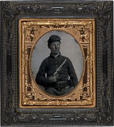 Unidentified soldier in Union uniform with Colt Army Model 1860 revolver. Sixth-plate tintype, hand-colored ; 12.4 x 11.2 cm (frame)