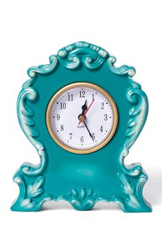 What a fun clock, love the color!