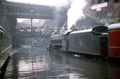 This is Glasgow Queen Street station on what is clearly a very wet morning in July, LMS Stanier 'Black 44972 is waiting to depart for Fort William. Diesel Locomotive, Steam Locomotive, Steam Trains Uk, Glasgow Architecture, Glasgow City, Steam Railway, Train Times, Railway Posters, British Rail
