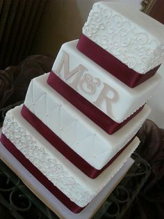 Maroon wedding cake! Whoop! -- is it weird that it's in our initials?!!