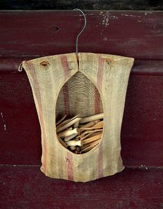 Homemade clothes pin bag. Hang it on the clothes line. Very worn but full of memories!