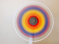 Paint a rainbow fan   This would be cute in other colors to match a room in, not crazy about the rainbow...