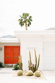 Vibrant door and white walls. For more, visit houseandleisure.co.za