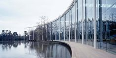 Foster + Partners designed the McLaren Technology Centre. The building is designed to reflect the company's design and engineering expertise.