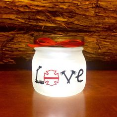 Firefighter Gift, Firefighter LOVE LED light. Custom Firefighter mason jar Firefighter night light, personalized Firefighter Gift, pint size This squatty pint size frosted glass jar can be personalized to meet your needs. Name, Dept Name, Even your own emblem in many cases. All text and emblems are created from permanent adhesive vinyl.  The interior is illuminated by a battery operated (3AAA) LED push light fastened inside the jar lid. Really a fun light for any firefighter or firefighter…