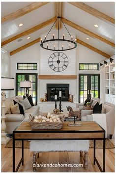 The great room in this Modern Farmhouse home features a custom painted brick and shiplap fireplace with a wood stained mantle that coordinates with the natural wood beams of the vaulted ceiling. Vaulted Living Rooms, Home Living Room, Open Kitchen And Living Room, Living Room Wood Floor, Dining Room, Shiplap Fireplace, Shiplap Ceiling, Vaulted Ceiling Lighting, Vaulted Ceiling Bedroom