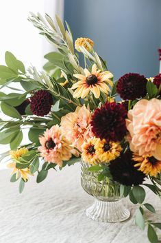 An Early Fall Centerpiece of Peach and Burgundy Flowers DIY from Jojotastic. Floral arrangement with dahlias Rudbeckia. Baptisia Foliage and Olive Foliage. Decor Style Home Decor Style Decor Tips Maintenance home Big Flowers, Fall Flowers, Beautiful Flowers, Flowers Garden, Altar Flowers, Summer Flowers, Wedding Flowers, Fall Floral Arrangements, Burgundy Flowers