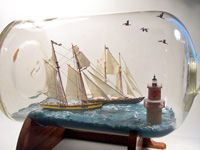 Exceptional ships-in-a-bottle diorama depicting the Pride of Baltimore II Racing Schooner Virginia Past Thimble Shoals Lighthouse.