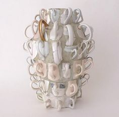 ...love the use of broken mug handles here... genius>Joan Bankemper