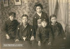 Japanese Family. Parents in Traditional Clothing. Boys in uniforms and girl in sailor suit.