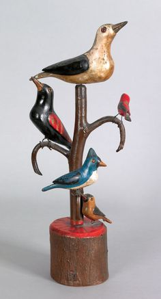 """Schtockschnitzler"" Simmons Berks County, Pennsylvania, active 1885-1910), carved and painted bird tree with five polychrome decorated birds, 15 1/2"" h. Illustrated in Machmer, Just For Nice, fig. 4. RICHARD MACHMER COLLECTION 2008"